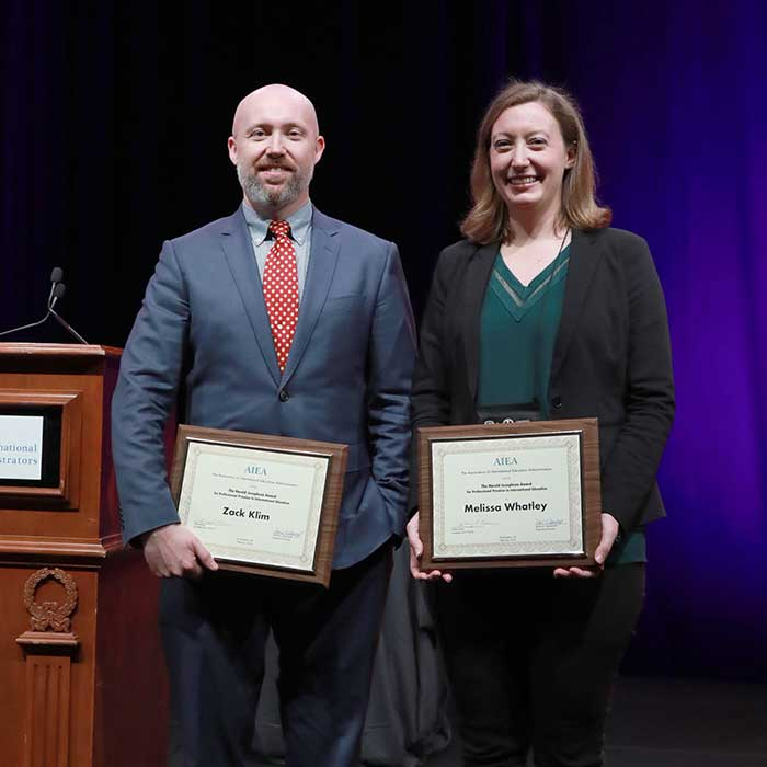 2018 Josephson Award Recipients Zachary Klim and Melissa Whatley on stage at the 2018 AIEA Networking and Awards Luncheon.